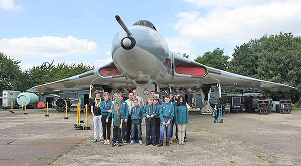 The scouts line up in front of XM655